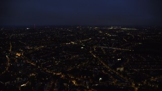 AX116_201 - 6K stock footage aerial video of flying over residential neighborhoods in London, England night