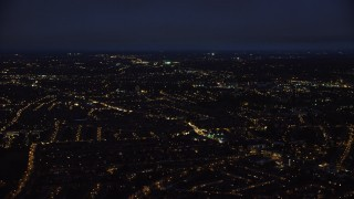 AX116_202 - 6K stock footage aerial video of flying by residential neighborhoods in London, England, night