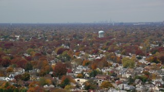 AX117_002 - 6K stock footage aerial video of a peaceful suburban residential neighborhood in Autumn, Farmingdale, New York