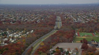 AX117_004 - 6K stock footage aerial video of Southern State Parkway in Autumn, Farmingdale, New York