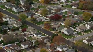 AX117_006 - 6K stock footage aerial video of suburban homes in Autumn, Massapequa, New York