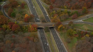AX117_007 - 6K stock footage aerial video of a freeway with light traffic in Autumn, Massapequa, New York