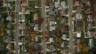 AX117_010 - 6K stock footage aerial video of a bird's eye of suburban neighborhood in Autumn, Massapequa, New York