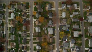 AX117_011 - 6K stock footage aerial video of bird's eye of suburban neighborhood in Autumn, Massapequa, New York