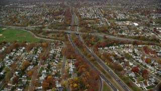 AX117_012 - 6K stock footage aerial video of a freeway interchange in Autumn, Massapequa, New York