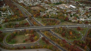 AX117_013 - 6K stock footage aerial video orbit freeway interchange in Autumn, Massapequa, New York