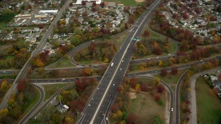 AX117_014 - 6K stock footage aerial video of an orbit of a freeway interchange in Autumn, Massapequa, New York