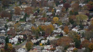 AX117_042 - 6K stock footage aerial video of suburban homes in Autumn, Bellmore, New York