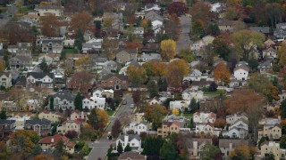 AX117_043 - 6K stock footage aerial video of flying by suburban homes in Autumn, Bellmore, New York