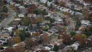 AX117_044 - 6K stock footage aerial video of an orbit of suburban homes in Autumn, Bellmore, New York