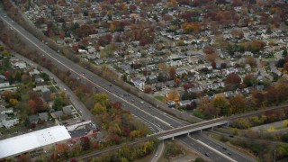 AX117_050 - 6K stock footage aerial video of light traffic on freeway in Autumn, Seaford, New York
