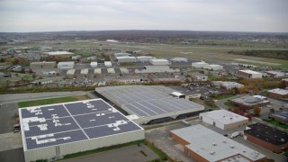 AX117_061 - 6K stock footage aerial video of Republic Airport in Autumn, Farmingdale, New York