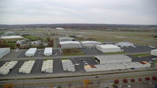AX117_062 - 6K stock footage aerial video of flying over Republic Airport in Autumn, Farmingdale, New York