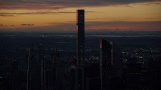 AX118_002 - 6K stock footage aerial video orbit 432 Park Avenue condo high-rise in Midtown Manhattan, New York City, sunrise