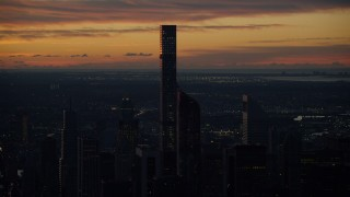 AX118_003 - 6K stock footage aerial video of an orbit of the 432 Park Avenue condo high-rise at sunrise, Midtown Manhattan, New York City