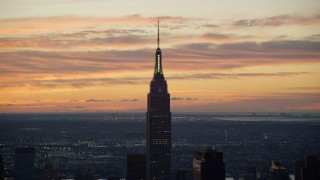 AX118_007 - 6K stock footage aerial video of the famous Empire State Building at sunrise in Midtown Manhattan, New York City