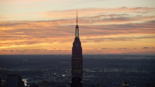 AX118_008 - 6K stock footage aerial video of an orbit of the Empire State Building at sunrise in Midtown Manhattan, New York City