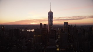AX118_017 - 6K stock footage aerial video of One World Trade Center at sunrise in Lower Manhattan, New York City