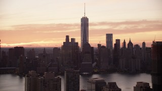 AX118_031 - 6K stock footage aerial video of the towering World Trade Center skyline at sunrise in Lower Manhattan, New York City