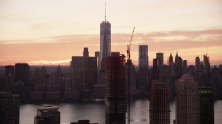 AX118_032 - 6K stock footage aerial video of World Trade Center skyline seen from Jersey City at sunrise in Lower Manhattan, New York City
