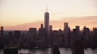 AX118_034 - 6K stock footage aerial video of Freedom Tower and World Trade Center skyscrapers seen from Jersey City at sunrise, New York City