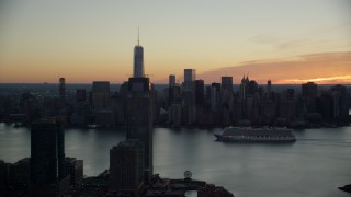 AX118_036 - 6K stock footage aerial video of cruise ship sailing Hudson River near World Trade Center at sunrise in New York City