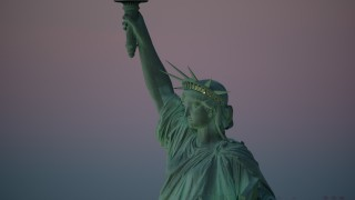AX118_060 - 6K stock footage aerial video of a profile view of the Statue of Liberty at sunrise, New York