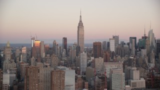 AX118_062 - 6K stock footage aerial video of Empire State Building at sunrise in Midtown Manhattan, New York City