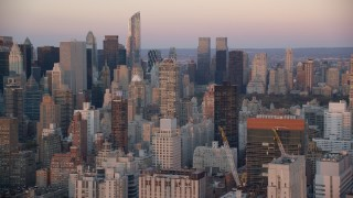 AX118_065 - 6K stock footage aerial video of high-rises at and skyscrapers at sunrise in Upper East Side, New York City