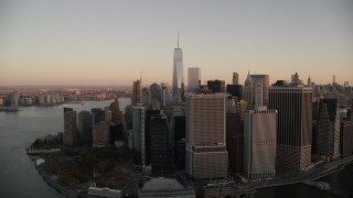 AX118_078 - 6K stock footage aerial video of Lower Manhattan skyscrapers and Battery Park at sunrise in New York City