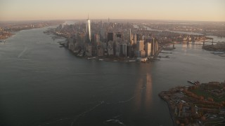 AX118_084 - 6K stock footage aerial video of a slow approach to skyscrapers in Lower Manhattan at sunrise, New York City