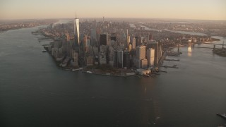AX118_085 - 6K stock footage aerial video approaching Battery Park and skyscrapers in Lower Manhattan at sunrise, New York City