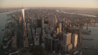 AX118_087 - 6K stock footage aerial video of Lower and Midtown Manhattan skyscrapers at sunrise, New York City