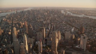 AX118_090 - 6K stock footage aerial video of Greenwich Village, East Village and Midtown at sunrise, New York City