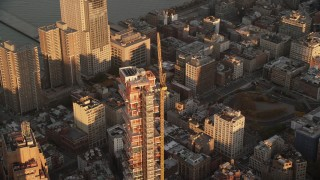 AX118_092 - 6K stock footage aerial video of 56 Leonard Street condo complex at sunrise in Tribeca, New York City
