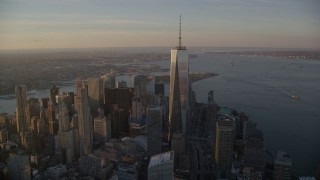 AX118_096E - 5.5K stock footage aerial video of a wide orbit of Freedom Tower at sunrise in Lower Manhattan, New York City