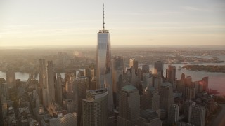 AX118_098 - 6K stock footage aerial video fly wide circle around Freedom Tower at sunrise in Lower Manhattan, New York City