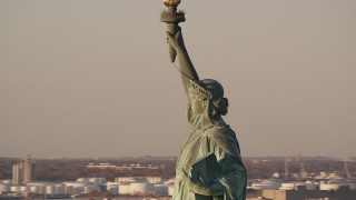 AX118_114 - 6K stock footage aerial video orbit left side of Statue of Liberty monument at sunrise in New York