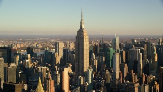 AX118_178 - 6K stock footage aerial video approach the iconic Empire State Building at sunrise in New York City