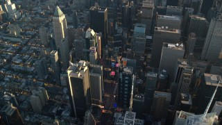 AX118_184 - 6K stock footage aerial video of Times Square at sunrise in New York City