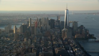 AX118_207 - 6K stock footage aerial video of Freedom Tower and Lower Manhattan at sunrise in New York City