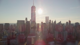 AX118_215 - 6K stock footage aerial video of Freedom Tower and World Trade Center skyscrapers at sunrise in New York City