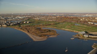 AX118_219 - 6K stock footage aerial video of approaching Waterfront Golf Course at sunrise in Jersey City, New Jersey