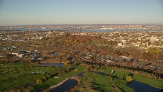 AX118_220 - 6K stock footage aerial video of freeway and cemetery at sunrise in Jersey City, New Jersey