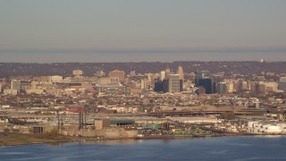 AX118_222 - 6K stock footage aerial video of waterfront refineries and skyscrapers in Newark, New Jersey