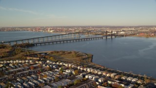 AX118_223 - 6K stock footage aerial video of Newark Bay Bridge and Lehigh Valley Bridge at sunrise in Newark, New Jersey