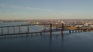 AX118_225 - 6K stock footage aerial video of an orbit of the Newark Bay Bridge and Lehigh Valley Bridge at sunrise in Newark, New Jersey