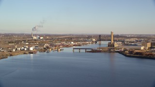 AX118_226 - 6K stock footage aerial video of riverfront factories and bridges at sunrise in Kearny and Newark, New Jersey