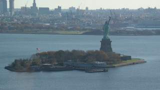 AX119_010 - 5.5K stock footage aerial video of orbiting the Statue of Liberty in Autumn, New York