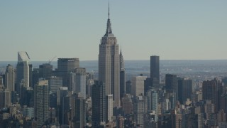AX119_023 - 6K stock footage aerial video of a wide orbit of the Empire State Building in Midtown, New York City